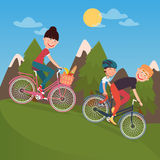Happy Family Riding Bikes in tho Mountains. Woman on Bicycle. Father and Son Stock Photo