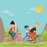 Happy Family Riding Bikes in tho Mountains. Woman on Bicycle. Father and Son Stock Photography