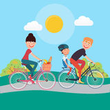 Happy Family Riding Bikes. Woman on Bicycle stock photo