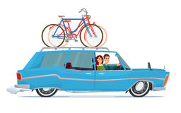 Happy family riding in a blue car. Bicycle trip. Stock Photos