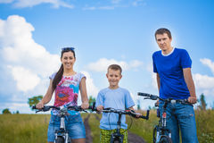 Happy family are riding in the field Stock Photo