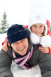 Happy family riding on snow slides in winter time. Family riding on snow slides in winter time royalty free stock images