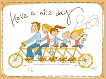 Happy family riding a tandem bicycle Royalty Free Stock Image