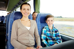 Happy family riding in travel bus Royalty Free Stock Photo