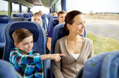 Happy family riding in travel bus Stock Photos