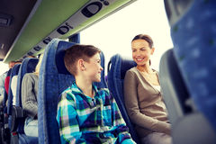 Happy family riding in travel bus stock images