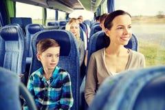 Happy family riding in travel bus Royalty Free Stock Photos
