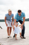 Happy family on the river bank. Picture of happy family on the river bank royalty free stock images