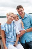 Happy family on the river bank Royalty Free Stock Photo