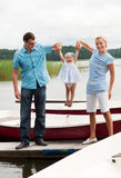 Happy family on the river bank Royalty Free Stock Images