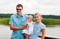 Happy family on the river bank Stock Image