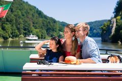 Family on river cruise looking at mountains from ship deck. Happy family on river cruise looking at mountains from ship deck royalty free stock photos