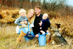 Happy Family by River in Late Autum Stock Photos