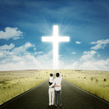 Happy family on the road with a cross Royalty Free Stock Photos