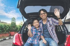 Happy family on a road trip, Sitting In Trunk Of Car stock image