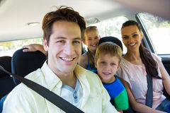 Happy family on a road trip Stock Photos