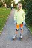 Happy family on roller skates in park. Stock Image