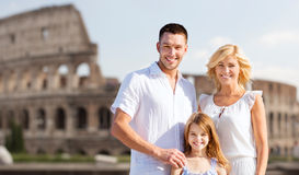 Happy family in rome over coliseum background Royalty Free Stock Image