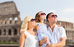 Happy family in rome over coliseum background Stock Image
