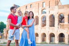 Happy family in Rome over Colosseo background. Italian european vacation together Royalty Free Stock Image