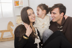 Happy family in the room Stock Photography
