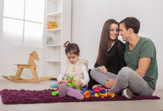 Happy family in room Stock Photo