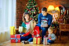 Family with gifts under the tree royalty free stock image