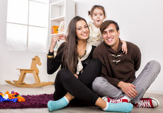 Happy family in the room Stock Images