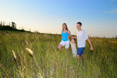 Happy family run in the field Royalty Free Stock Photos