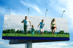 Happy family run on grass Stock Photo