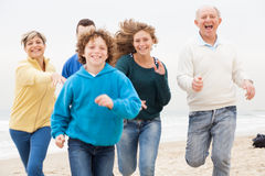 Happy family running on the beach Royalty Free Stock Photography