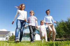 Happy family running Stock Photo
