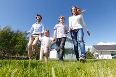 Happy family running Stock Photography