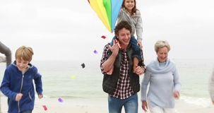 Happy family running with kite stock footage