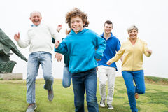 Happy family running at the lawn Royalty Free Stock Photography