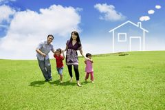 Happy family running in the meadow Stock Photo