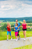 Happy Family is running outdoors in summer Royalty Free Stock Photos