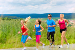 Happy Family is running outdoors in summer Stock Images