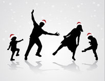 Happy family in Santa Claus hat Royalty Free Stock Photos