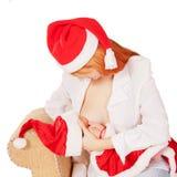 Happy family in Santa Claus hats. Royalty Free Stock Photo