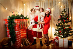Happy family with Santa Claus laughing and smiling. Mother,  dau Royalty Free Stock Images