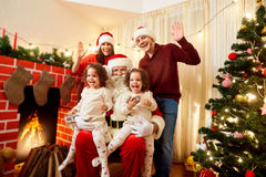 Happy family with Santa Claus laughing and smiling. Mother, fath royalty free stock image