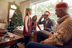 Happy family with santa hat and crown on christmas eve Royalty Free Stock Photos
