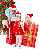 Happy family in santa hat holding gift box. Stock Image