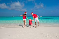 Happy family in Santa Hats on beach during Stock Image