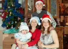 Happy family  in santa hats celebrating Christmas Royalty Free Stock Photo