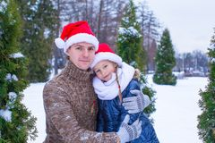 Happy family in Santa hats with christmas tree Stock Images