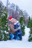 Happy family in Santa hats with christmas tree Royalty Free Stock Photography