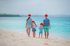 Happy family in Santa Hats during tropical Christmas vacation Stock Photography
