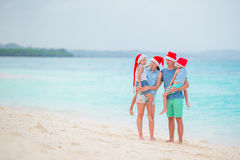 Happy family in Santa Hats during tropical Christmas vacation Stock Image